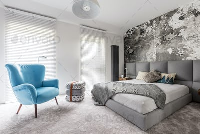 Bedroom with vintage blue armchair