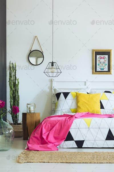Geometric bedroom design, triangle quilt