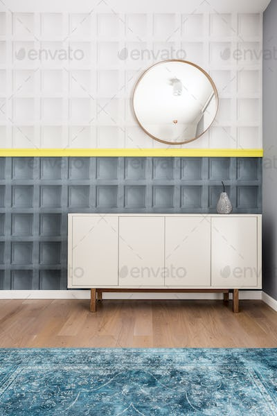 Room with chest of drawers