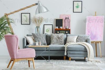 Pink armchair on grey carpet