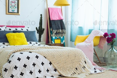 Trendy bedroom with colorful bedding
