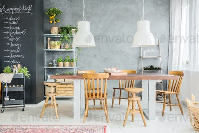 Wooden table and chalkboard wall