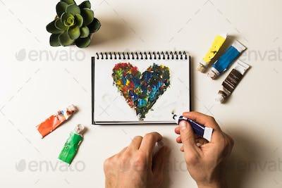 Acrylic hearts on notebook