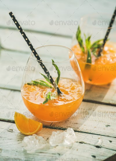 Refreshing cold alcoholic summer citrus cocktail with orange