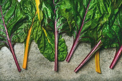 Flat-lay of fresh green leaves of swiss chard, top view