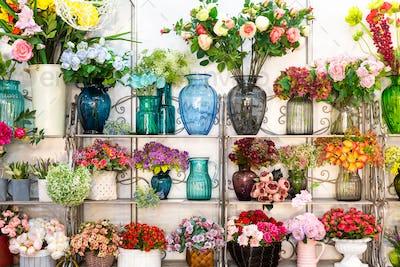 Flower shop, bouquets on shelf, florist business
