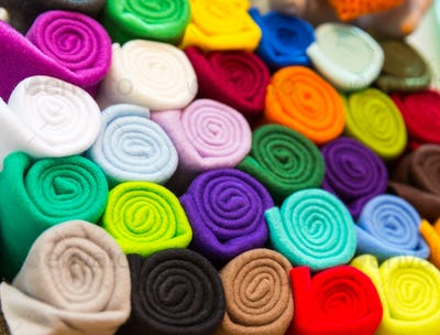 Colorful towels rolled into a tube closeup