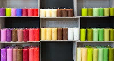 Colorful candles on shelf in decoration shop