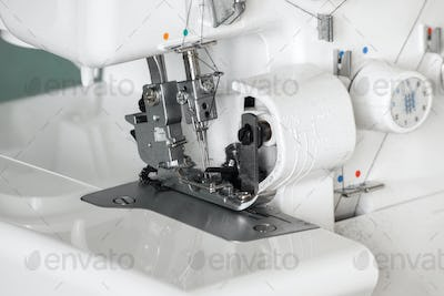 The mechanism of the needle of the sewing machine close-up