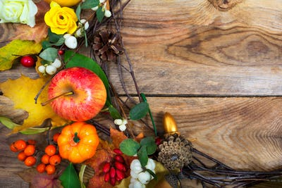 Holidays background with pumpkins, apple, maple leaves wreath, c