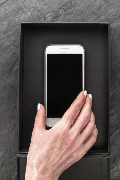 Black Friday, box and phone in hand close-up