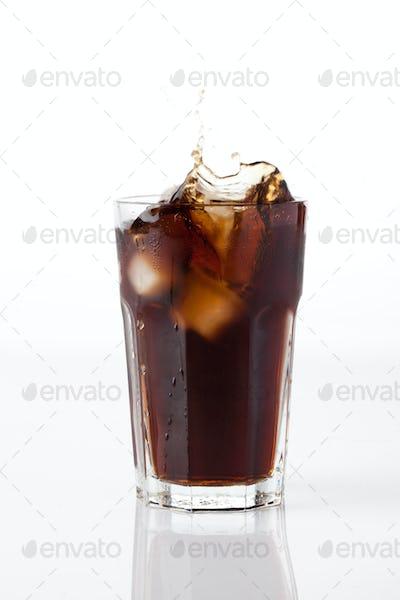 cola splash with ice