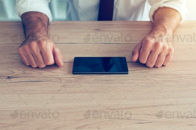 Businessman fighting mobile phone addiction crisis