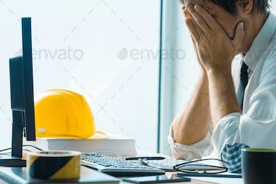 Worried interior design professional working in office