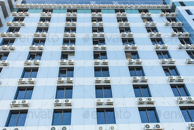Wall with many air conditioners