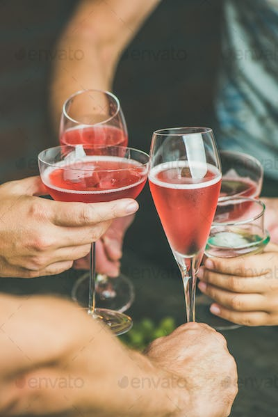 People having party, gathering, celebrating with rose champaign, vertical composition