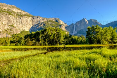 Meadow with flooded boardwalk and Yosemite Falls