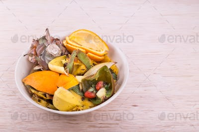 Bowl of household vegetable and fruits refuse collected for comp