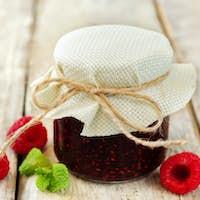 Raspberry jam with mint and fresh raspberries