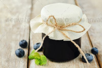 Blueberry jam with mint and fresh blueberries