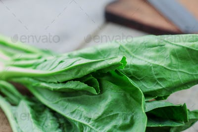 Leaves of kale on wooden