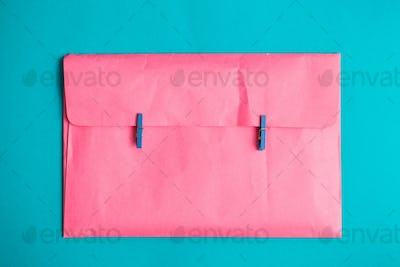 The pink envelope holds the clothespins. Minimalism