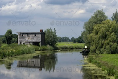 Run-down shed on the bank of the river Giessen near Hoornaar in the Dutch region Alblasserwaard