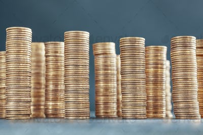 Stacks of golden coins, selective focus