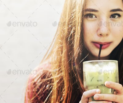Woman refreshing herself with green tea
