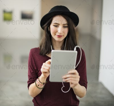 Woman listening to music from her tablet
