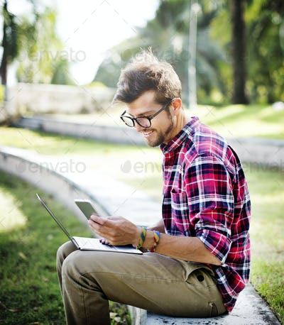 Young Man Browsing Smartphone Concept