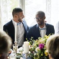 Cheerful Gay Couple in Wedding Reception