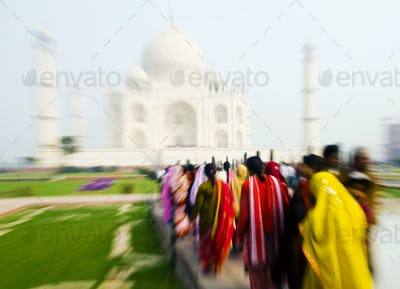 People walking through the Taj Mahal.
