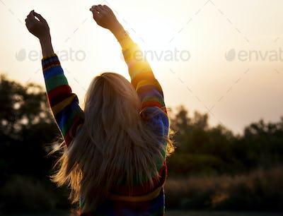 Woman stretching wake up morning sunlight