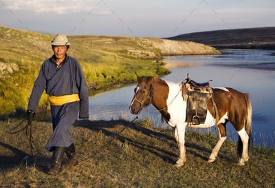 Horse man walking with his horse