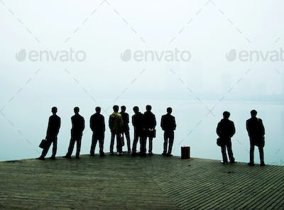 Men looking out over lake.