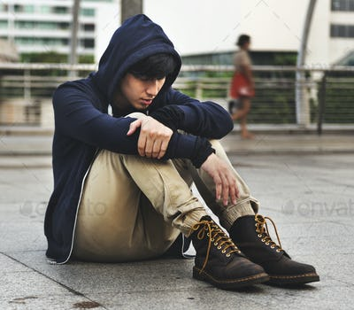 Asian Guy Sit on the Street Depression