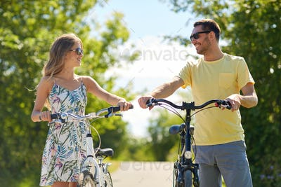 happy couple with bicycles on country road
