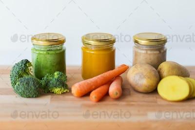 vegetable puree or baby food in glass jars