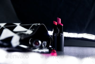 Black and white make up bag with set of lipsticks