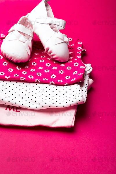 Folded pink bodysuit