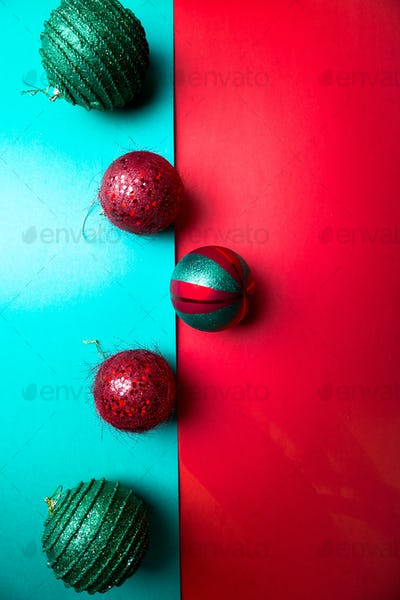 Christmas ball on green and red pepper backround.