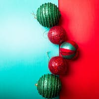 Christmas ball on green and red paper