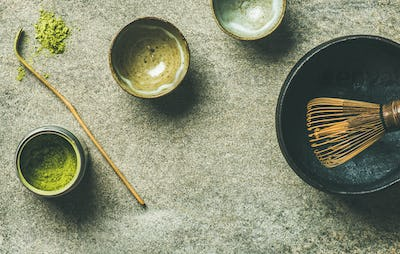 Japanese tools for brewing matcha tea, grey background, copy space