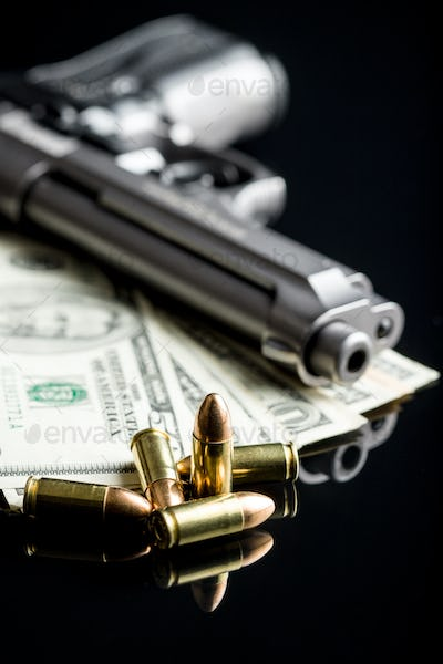 9 mm bullets, dollars and handgun.