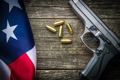 Pistol bullets, handgun and USA flag.