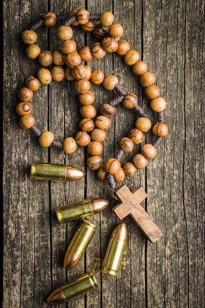 Rosary beads and pistol bullets.