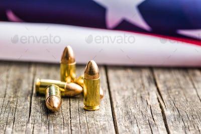 Pistol bullet and USA flag.