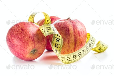 Fresh apples and measuring tape.