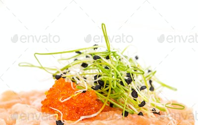 Salmon tartare with sprouts and red caviar.